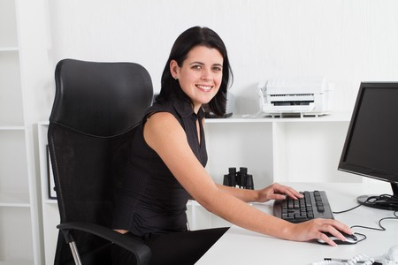 businesswoman in office Stock Photo - 7642617
