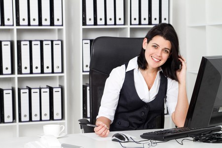 happy businesswoman in office Stock Photo - 7642610