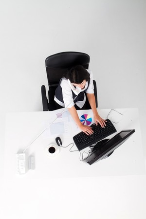 overhead of businesswoman working at desk Stock Photo - 7642596