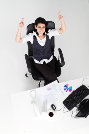 happy businesswoman with fingers crossed photo