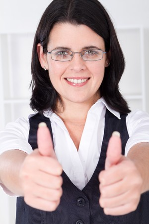 young businesswoman thumbs up photo