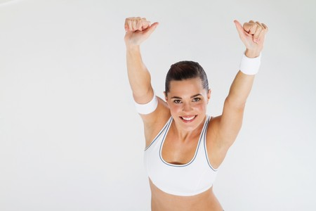 overhead view of fitness woman giving thumbs up Stock Photo - 7639020