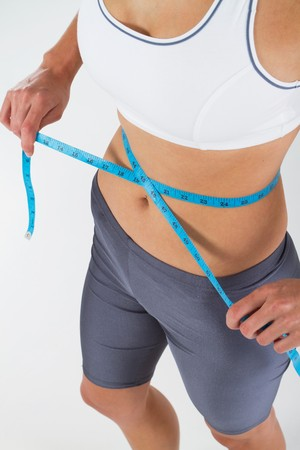 fit woman measuring her waist Stock Photo - 7639070
