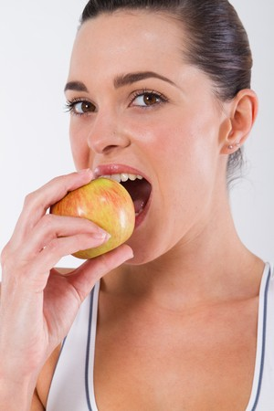 healthy young woman eating apple Stock Photo - 7639072