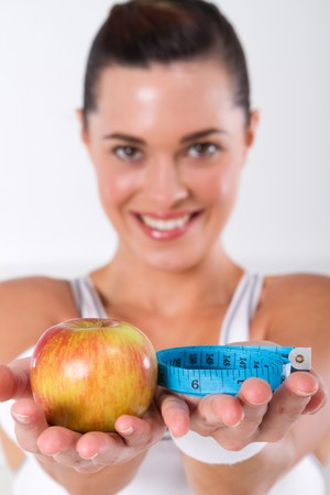 fitness woman holding apple and tape measure Stock Photo - 7639064
