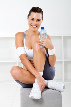 beautiful fitness woman holding a bottle of water photo