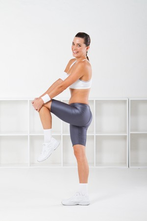 gorgeous young fitness woman stretching Stock Photo - 7639018