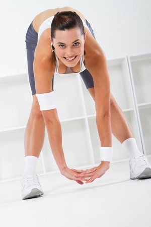 a pretty fitness woman stretching photo