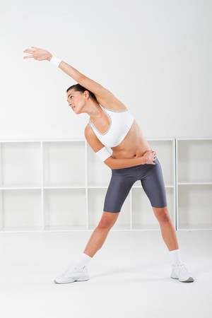 pretty fitness woman stretching Stock Photo - 7639013