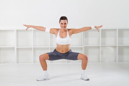 a pretty young fitness woman stretching Stock Photo - 7639046