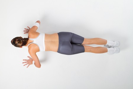 overhead view of woman doing push ups photo
