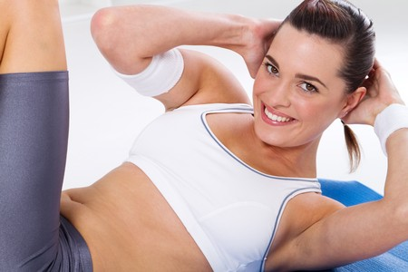woman working out: pretty fitness woman doing sit ups