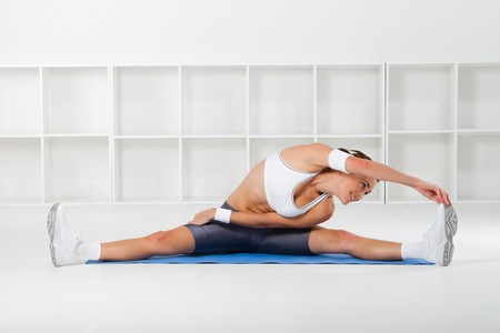 young fitness woman stretching Stock Photo - 7639001