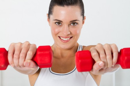 pretty woman working out with dumbbells photo