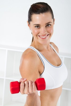 muscle toning: fitness woman exercising with dumbbell