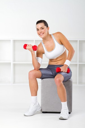 pretty young fit woman working out photo