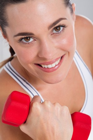 close-up of woman using dumbbells photo