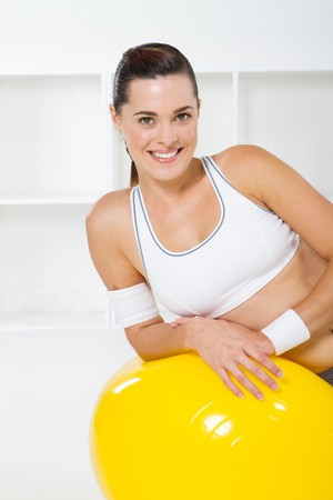 fit woman exercising with exercise ball photo