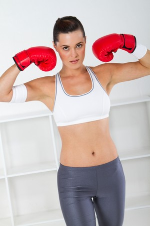 sit shape: fitness woman wearing red boxing gloves