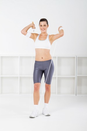 fitness woman jumping rope photo