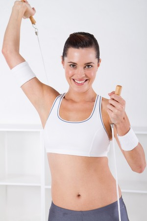 fitness woman holding jump rope  photo