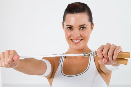 pretty fitness woman holding skipping rope photo