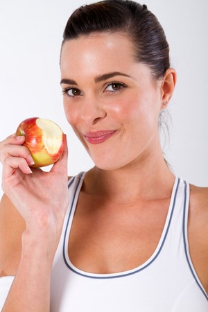 healthy fitness woman eating apple photo