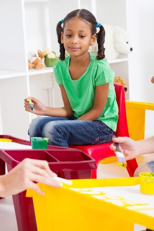 pretty indian preschool girl in classroom Stock Photo - 7795771