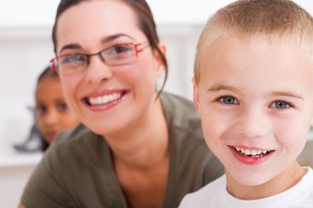 preschool classroom: close-up of happy teacher and young student