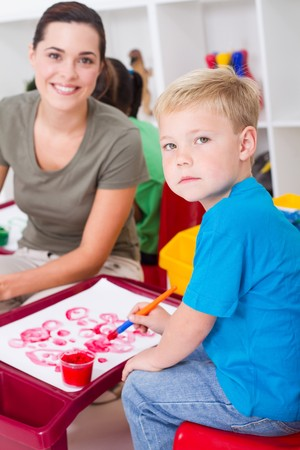 happy teacher and young preschool students Stock Photo - 7795789