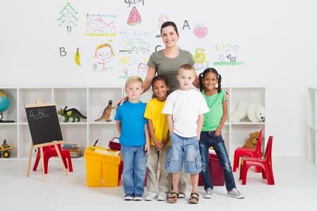 kindergarten toys: young teacher and kindergarten students