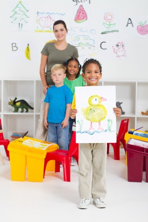 happy indian preschooler presenting his painting Stock Photo - 7795731