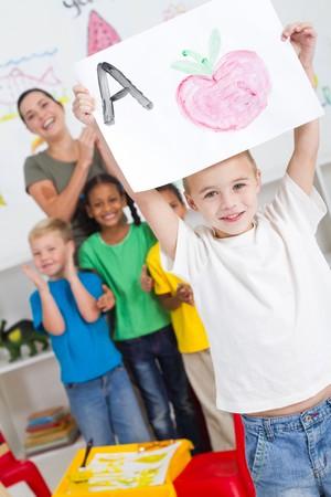 happy preschool boy with classmates photo