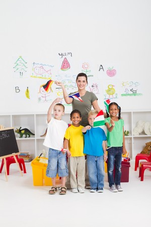 happy preschoolers and teaching waving flags in classroom photo