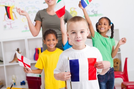 south africa flag: little french boy with diverse classmates in background