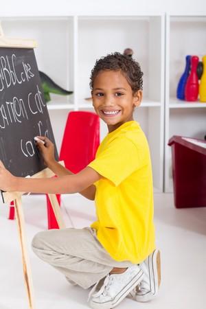 carefree: happy indian kindergarten boy in classroom