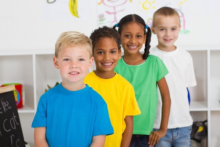 learners: happy preschoolers in a row Stock Photo