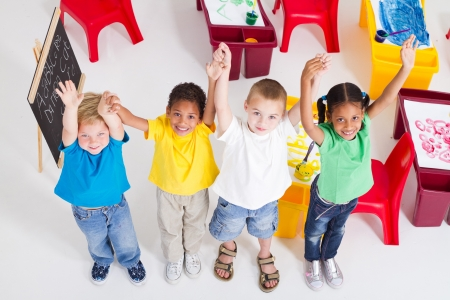 diverse hands: overhead of happy preschool kids