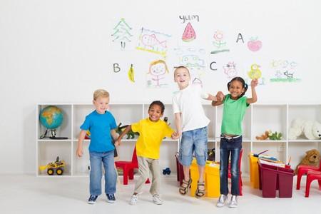 kindergarten toys: preschool kids jumping in classroom
