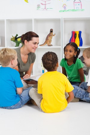 preschool teacher reading children books Stock Photo - 7795769