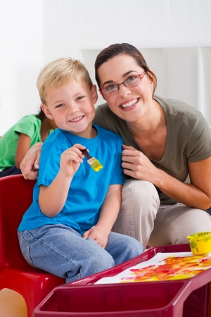 happy teacher with young student photo