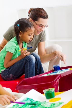 art teacher helping young student painting Stock Photo - 7795783