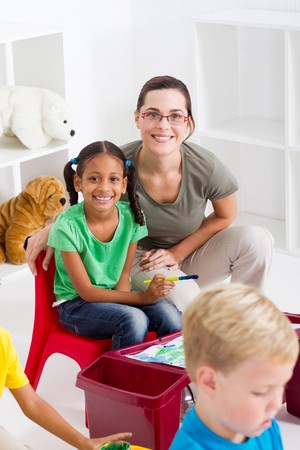 happy teacher and young students Stock Photo - 7795763