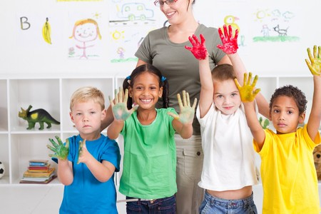 preschool kids with paint on hands  photo