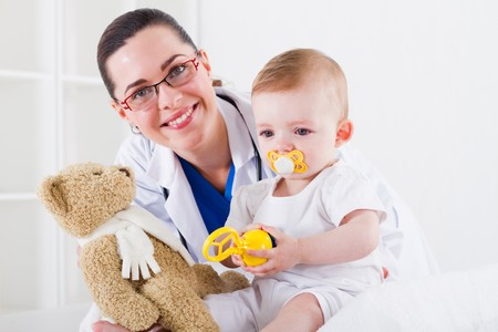 portrait of pediatrician and baby photo