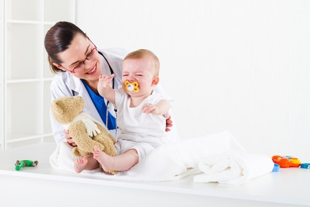 pediatric: paediatrican and crying baby Stock Photo