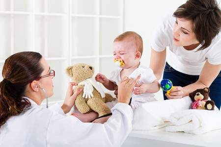 pediatrics: nurse checking crying baby