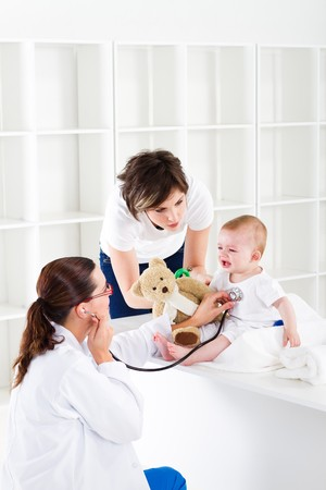 doctor toys: doctor giving young baby a checkup