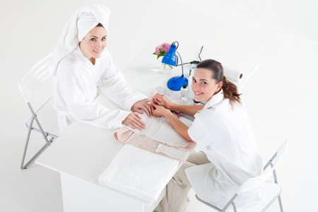 woman having manicure in beauty salon photo
