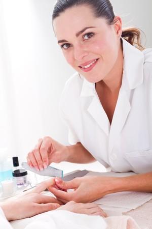 manicurist: pretty young manicurist Stock Photo